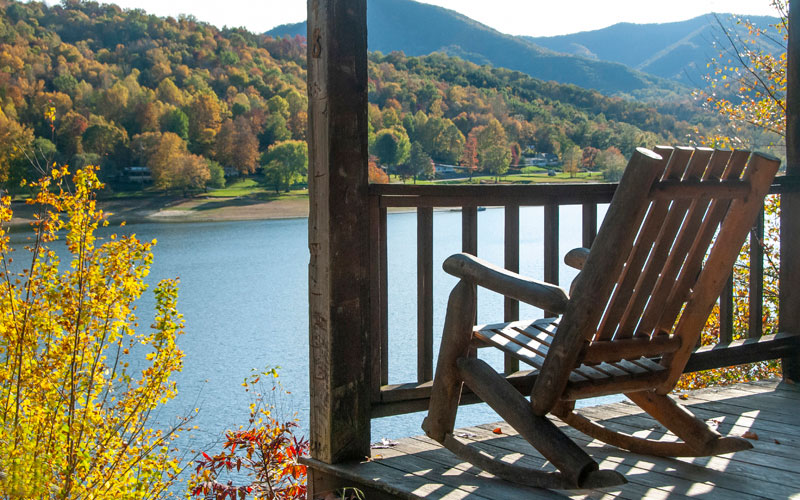 rockiing chair on covered porch lake view